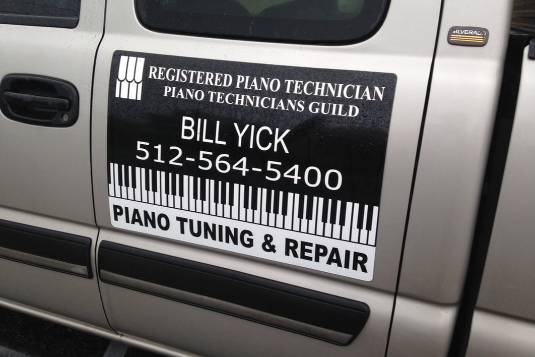 Piano tuning sign on truck